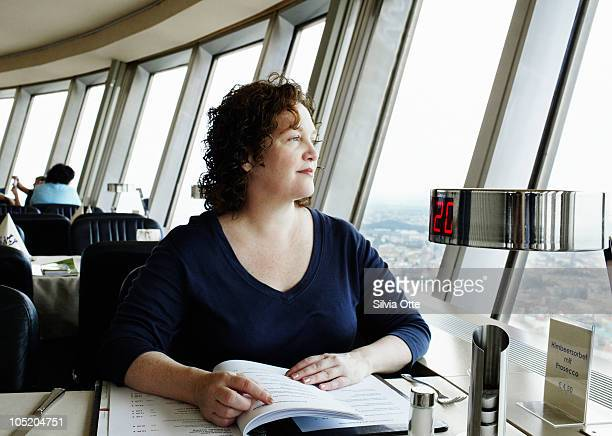red haired woman in rotating restaurant