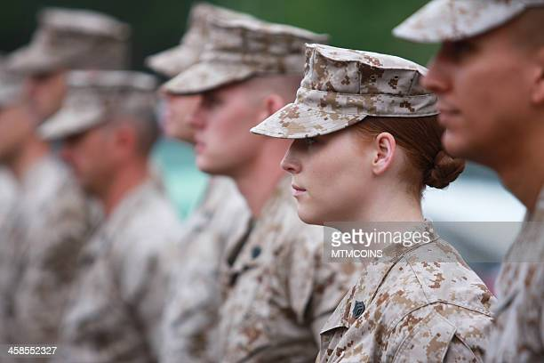 red haired woman marine in formation - marines military stock photos and pictures