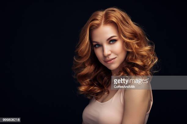 red haired woman - permed hair stock photos and pictures