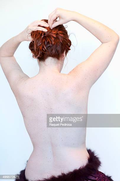 Red haired woman with bare back