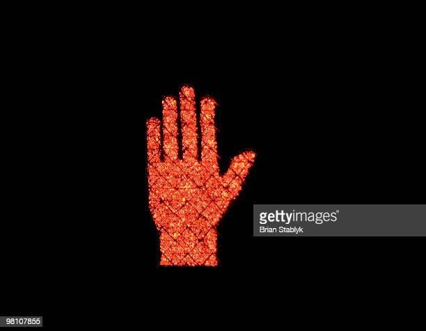 red hand stop symbol for traffic light - walk don't walk signal stock pictures, royalty-free photos & images
