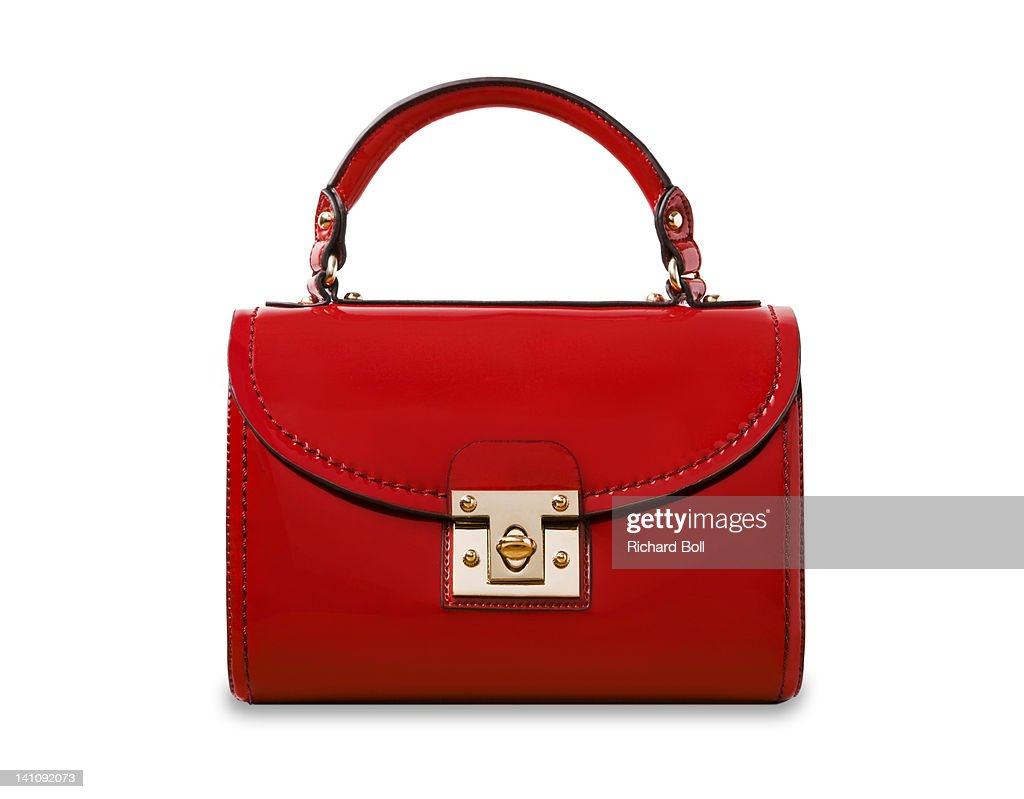 A red handbag on a white background. : Stock Photo