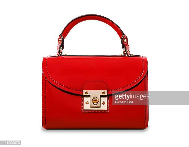 A red handbag on a white background.