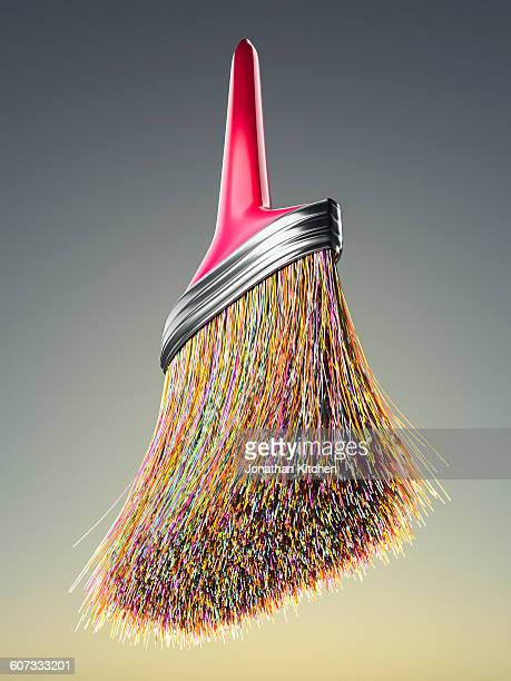 Red handled multi coloured brush