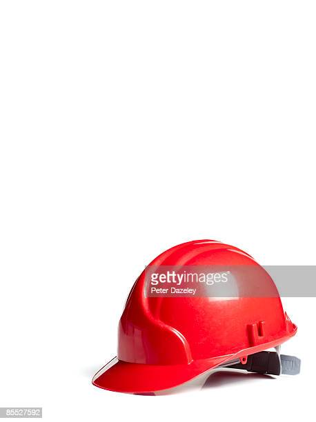 Red hard hat on white background.
