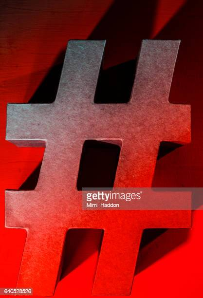 3-D Red Hashtag # symbol in Red Light
