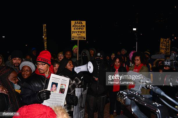 Red hat Nicholas Heyward who lost his son in a police shooting speaks to the crowd at rally held at One Police Plaza the Day after NYPD Officer Peter...