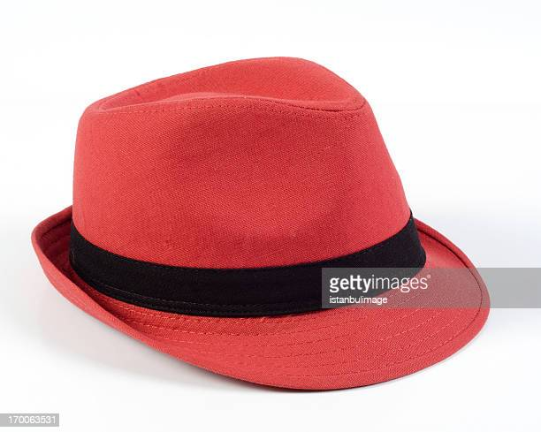 Red hat with black ribbon on top