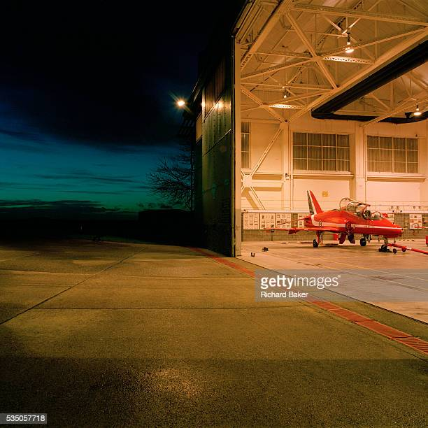 A red Hawk jet aircraft belonging to the elite 'Red Arrows' Britain's prestigious Royal Air Force aerobatic team is parked in the hangar at RAF...