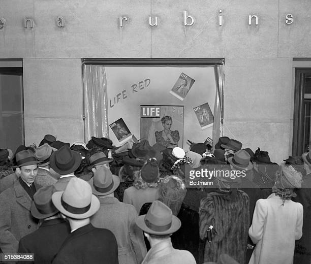 A red head a blonde a brunette and medium type as still life in competition with wax models in the window of Helena Rubinstein's beauty shop at 54th...