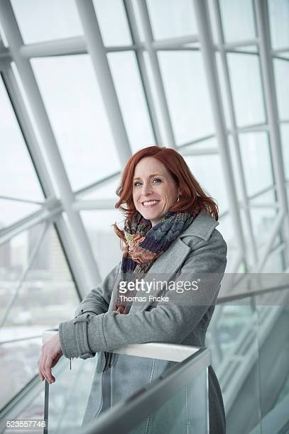 red head woman at window - older redhead stock pictures, royalty-free photos & images