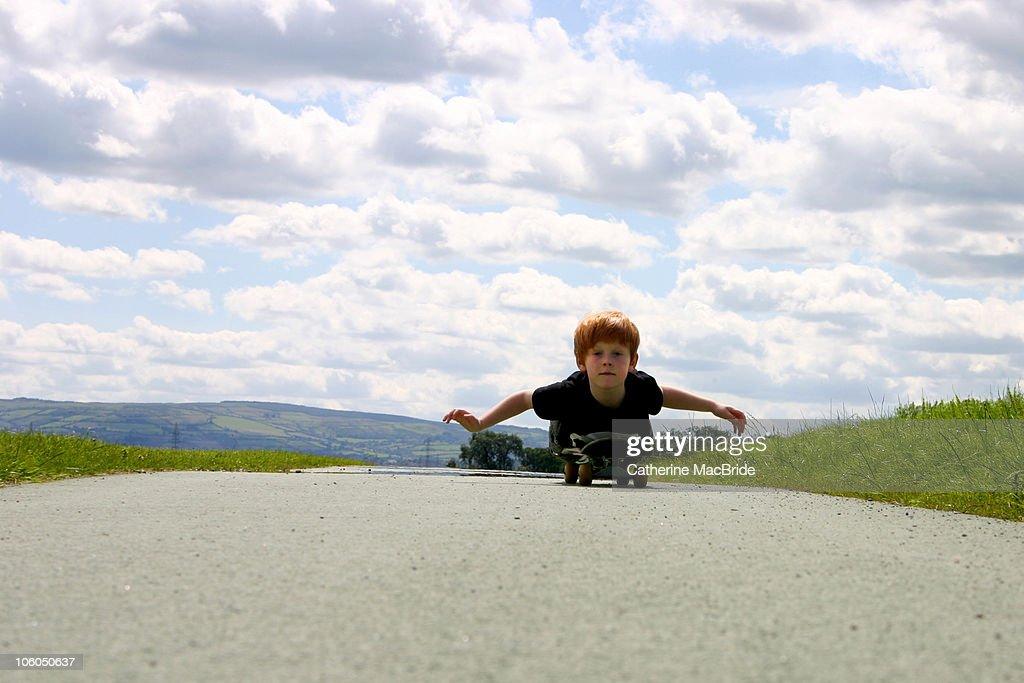 Red Headed Boy Skateboarding : Stock Photo