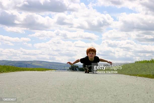red headed boy skateboarding - catherine macbride imagens e fotografias de stock