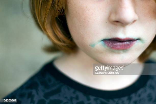 a red headed boy with blue ice-pop on his face - catherine macbride stock-fotos und bilder