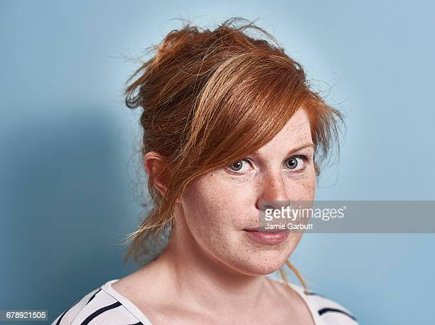Red headed British female with slight smile
