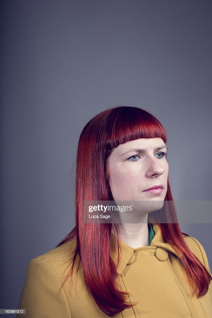 Red Headed Female in thought : Stock Photo