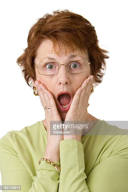 red headed woman imitating the home alone child - old ugly woman stock photos and pictures