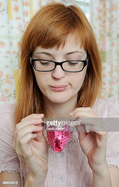 Red headed woman looking into her purse
