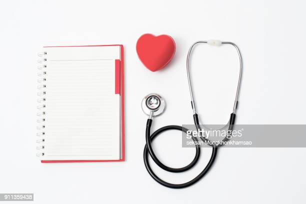 Red heart and a stethoscope. Healthcare and Medicine concept . On white background.