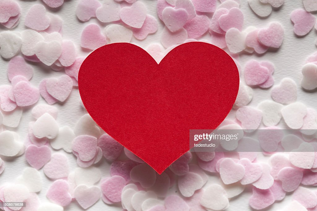 Red heart and pink hearts in background : Stock Photo