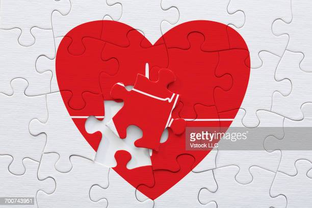 red heart and pulse trace puzzle with missing piece - heart disease stock pictures, royalty-free photos & images