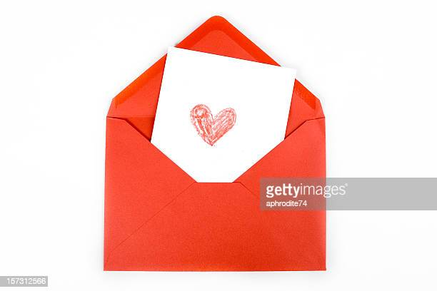 red heart drawn on white card within red envelope - love letter stock photos and pictures