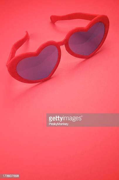 Red Heart Glasses on Bright Background