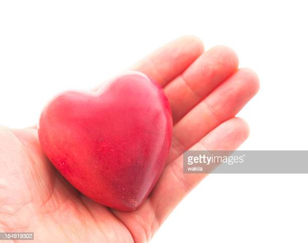 red heart in hand with copyspace