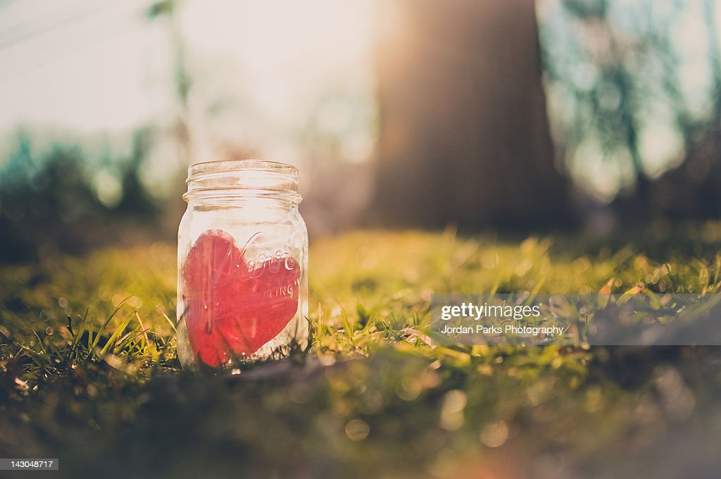 Red heart in mason jar : Stock Photo
