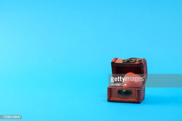 red heart in treasure box - antiquities stock pictures, royalty-free photos & images