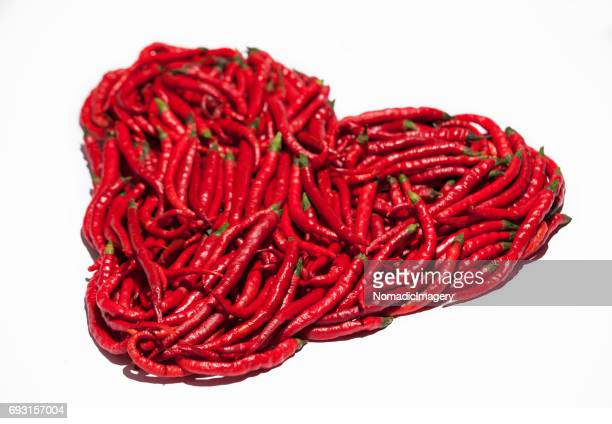 Red heart made of red chili peppers