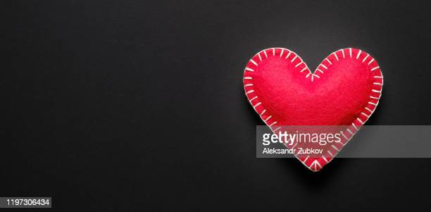 red heart on a black background. health insurance concept, world health day, world hypertension day, health protection. - charity benefit stock pictures, royalty-free photos & images