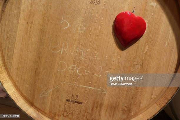 A red heart on an oak barrel containing Sangiovese wine in Casato Prime Donne winery's cellar signifies that it is marked for the winery's premium...
