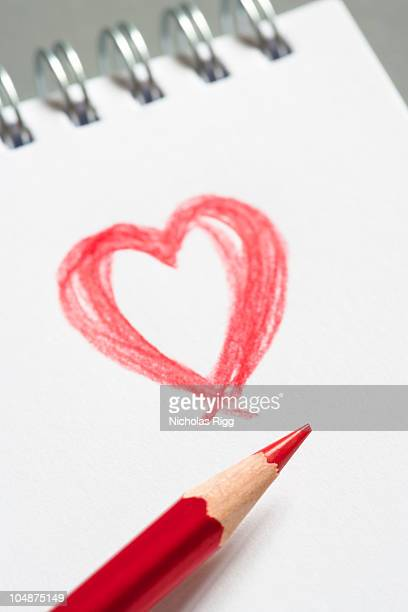 Red heart on paper pad