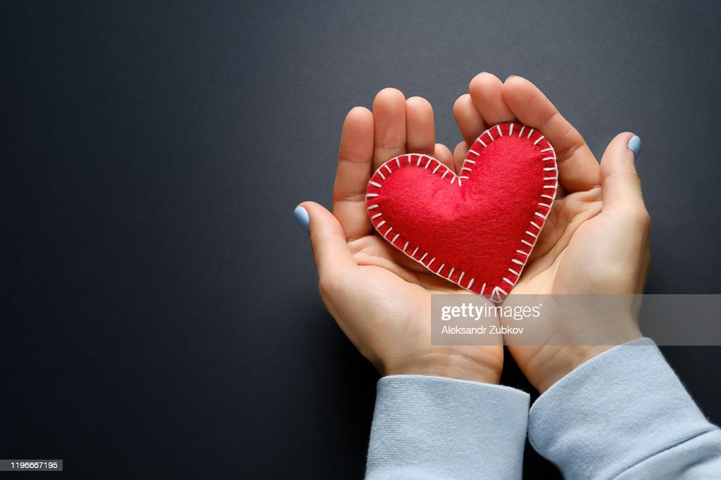 Red Heart Or Valentine In The Hands Of A Girl On A Black Background The Concept Of Celebrating Valentines Day Symbol Of Love High Res Stock Photo Getty Images