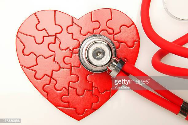 Red heart Puzzle with stethoscope