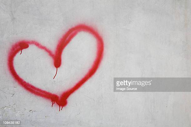 red heart shape on white wall - tag photos et images de collection