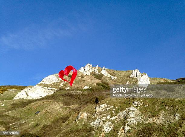 Red Heart Shape Over Mountain