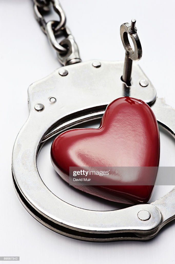 Red Heart Shape With Handcuff Photo - Getty Images