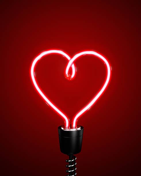 Red heart shaped energy saving lightbulb