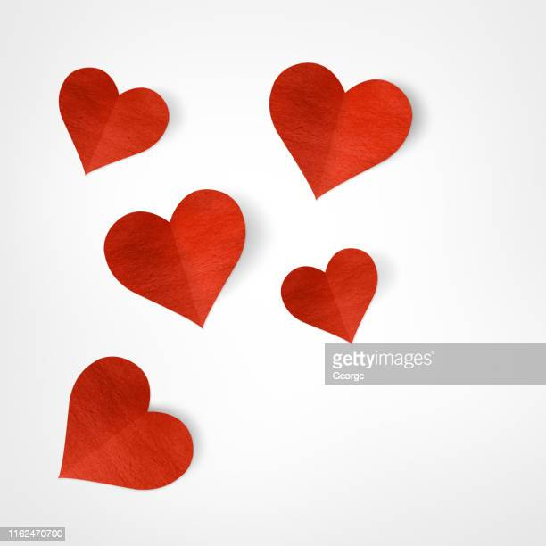 red heart with paper cut shapes - valentines day fotografías e imágenes de stock