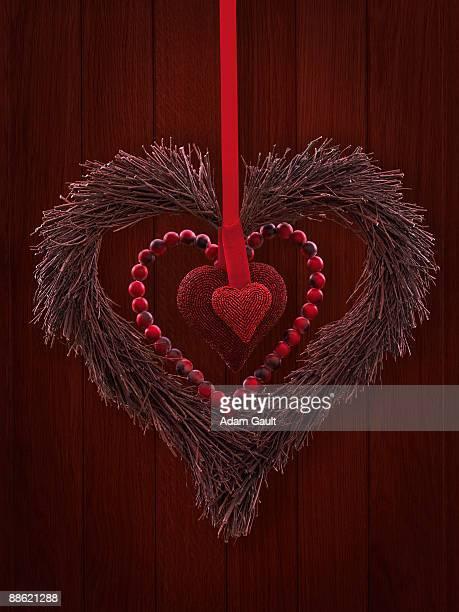 Red heart wreath hanging on door