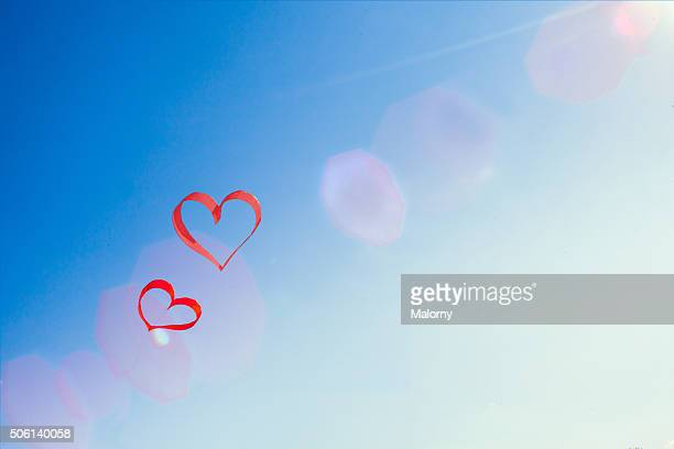 Red hearts and blue sky. Love is in the air.