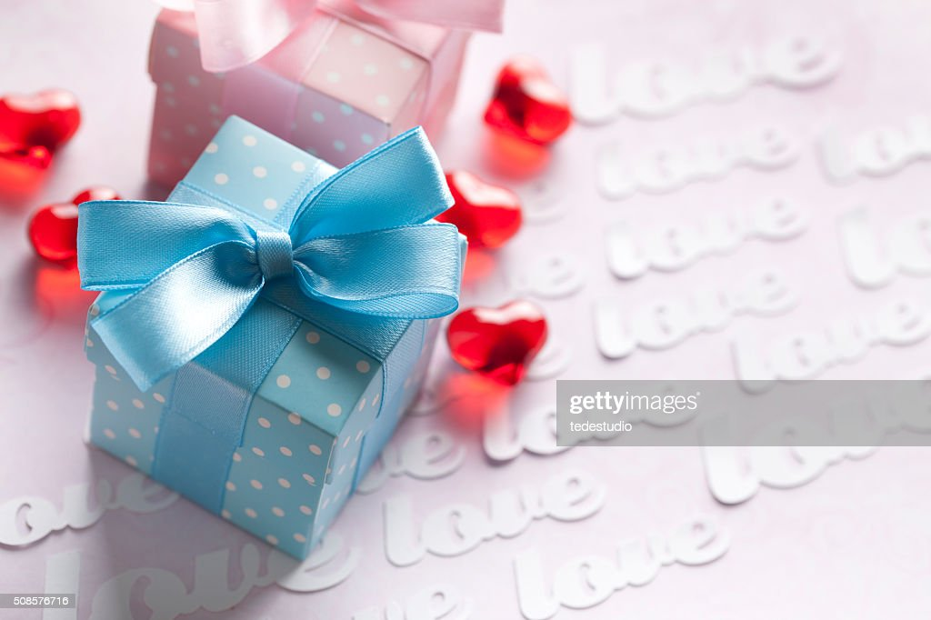 Red hearts and gift boxes on pink background : Stock Photo