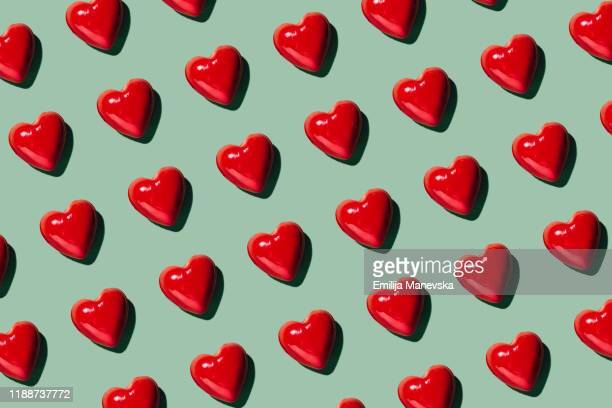 red hearts background - love stock pictures, royalty-free photos & images