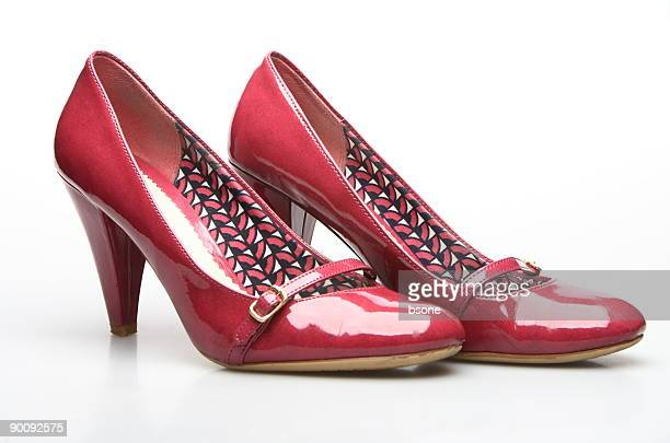 red heels on white - pump dress shoe stock pictures, royalty-free photos & images