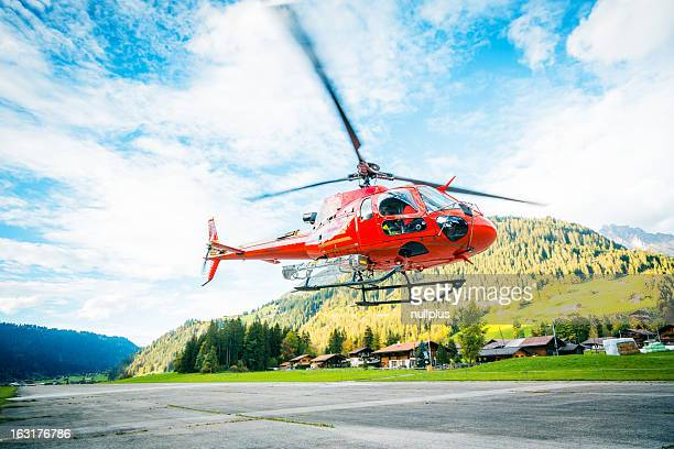 red helicopter in the swiss alps