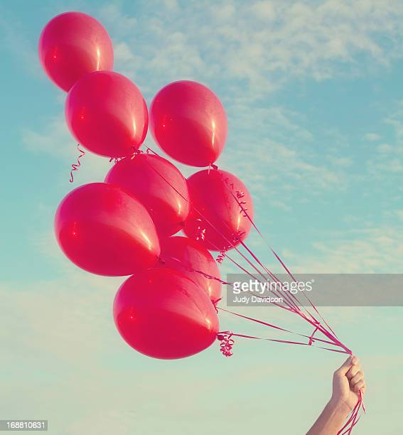 red helium balloons - atlantic beach north carolina stock pictures, royalty-free photos & images
