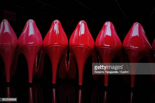 red high heels against wall - high heels stock pictures, royalty-free photos & images