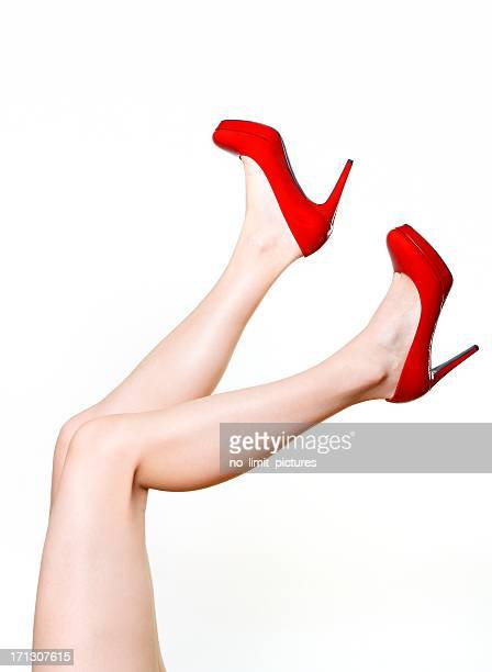 red high heels - beautiful legs in high heels stock photos and pictures